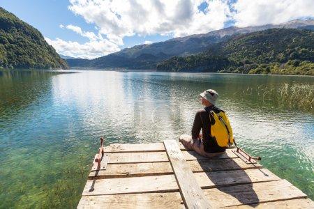 Man on  mountain lake