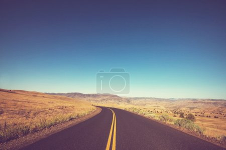Road in prairie with panorama