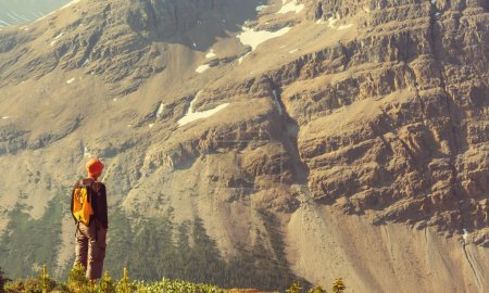 Hiking man in mountains