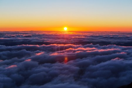 Photo for Beautiful sunset on the hill above clouds - Royalty Free Image