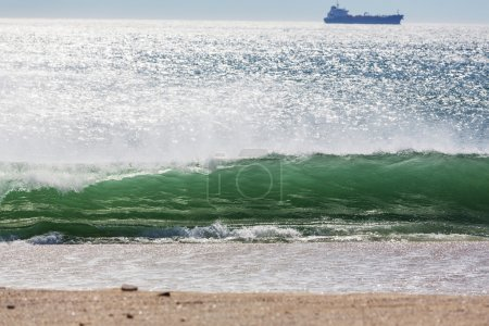 Ocean wave and ship