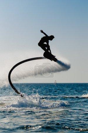 Silhouette of a hover board rider