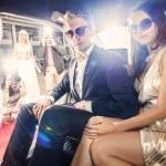 Постер, плакат: Celebrity couple in a limousine