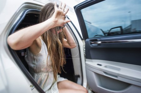 Photo for Celebrity Star getting out of a stretch limo, shielding herself with her hands - Royalty Free Image