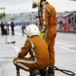 Pit Crew anticipating the arrival of their race ca...