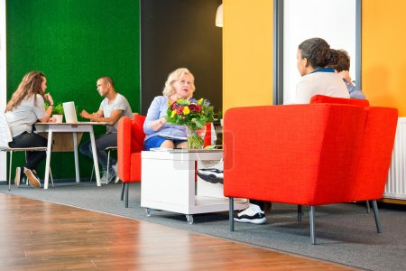 people sitting in a business lounge