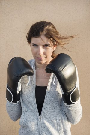Confident Woman Wearing Boxing Gloves