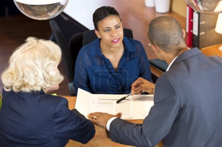 Businesspeople Talking To Receptionist