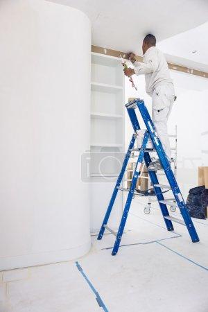 Painter filling screw holes