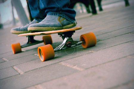 Feet on a long board