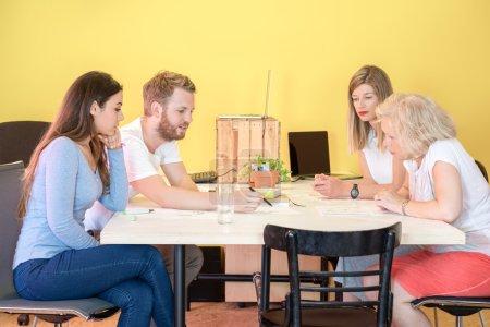 designers discussing at desk