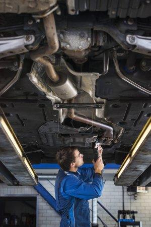 mechanic testing exhaust system