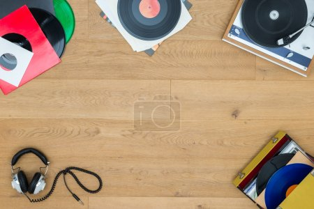Records With Turntable On Wooden Table
