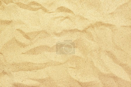 Top view of yellow beach sand texture, summer holiday background