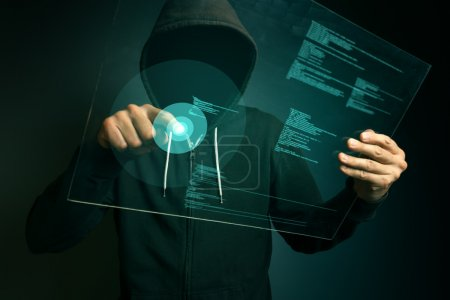 Hooded computer hacker hacking biometric security internet syste