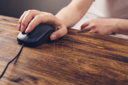 Photo for Woman using computer mouse, selective focus on female hand and pointing device on office desk - Royalty Free Image