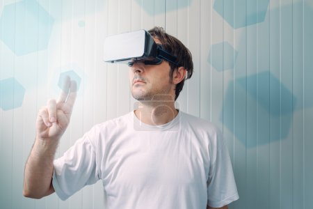 Photo for Man with VR goggles working in virtual reality environment, casual male person exploring modern technology. - Royalty Free Image