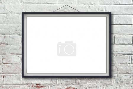 Photo for Blank horizontal painting poster in black frame hanging on white brick wall. Painting proportions match international paper size A. - Royalty Free Image