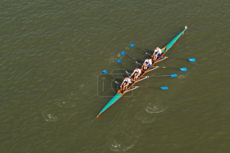 Four men rowing on Danube river