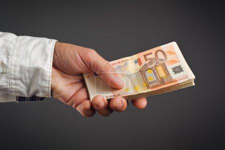 Money Loan. Bank officer loaning stack of euro ban...