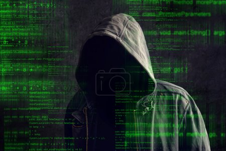 Faceless hooded anonymous computer hacker with pro...