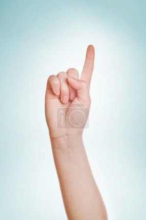 Hand with index finger raised up