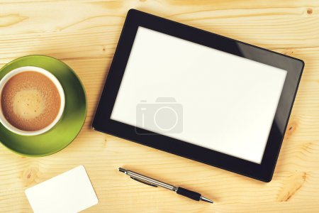 Photo for Tablet Computer With Blank White Screen as Copy Space on Office Table. - Royalty Free Image