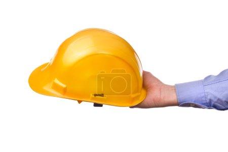 Photo pour Casque protecteur industriel jaune pour homme. Partie de la série d'images avec des outils de bricolage pour les travaux à la maison et l'artisanat à la main isolé sur fond blanc . - image libre de droit