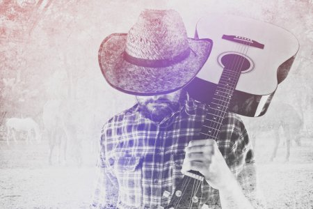 Photo for Bearded Cowboy Farmer with Acoustic Blues Guitar and Straw Hat on Western American Horse Ranch, Double Exposure Image. - Royalty Free Image