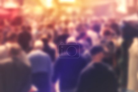 Photo for Blurred Crowd of People On Street, unrecognizable crowded population as blur urban background, Vintage Toned Image. - Royalty Free Image
