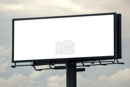 Photo for Blank Outdoor Advertising Billboard Hoarding Against Cloudy Sky, White Copy Space for Mock Up Design or Marketing Message - Royalty Free Image