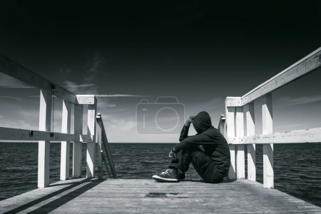 Alone Man at the Edge of Wooden Pier