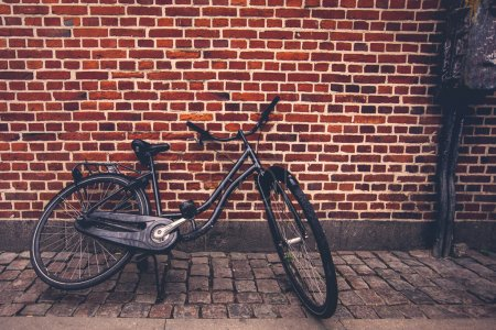 Photo for Classic Vintage Black Hipster Bicycle on the Street, Retro Toned Image - Royalty Free Image