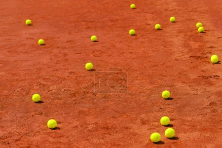 Tennis balls on clay court