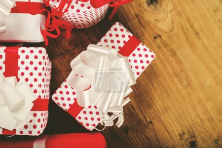 Photo for Christmas presents and gifts on old oak wood table, top view, copy space, retro toned, selective focus - Royalty Free Image