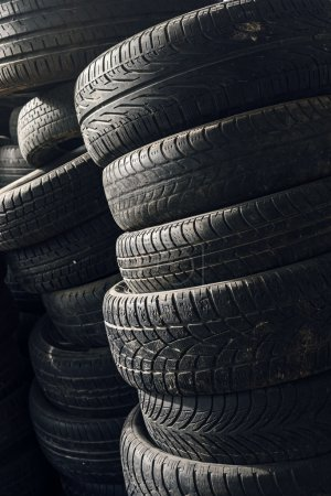 Column stack of old used car tires