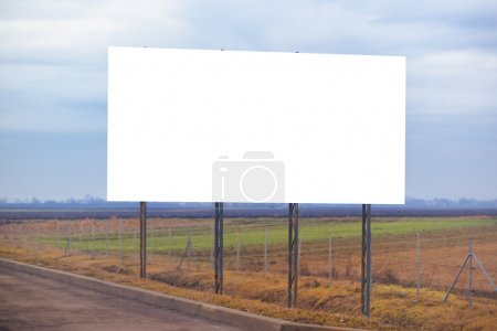 Photo for Blank billboard hoarding by the roadway, copy space for graphic design mock up. - Royalty Free Image