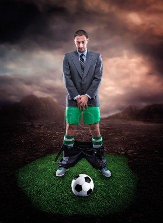 Businessman in sportwear protecting genitals