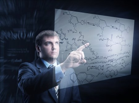 Businessman working with chemistry chart
