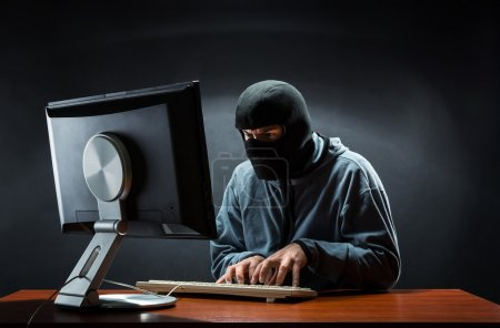 Hacker in balaclava mask