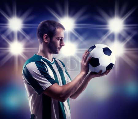 Football-player holding ball