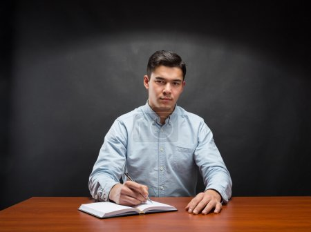 student sitting at the wooden table