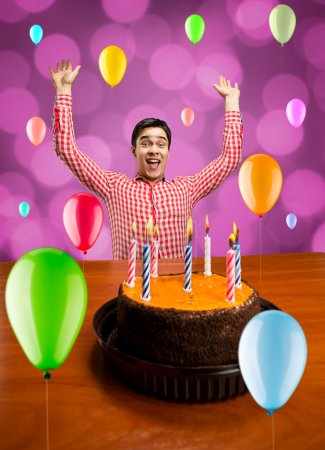 Photo for Young smiling man celebrating birthday - Royalty Free Image