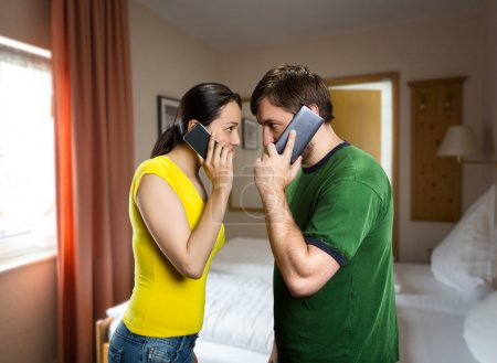 Couple talking by phones