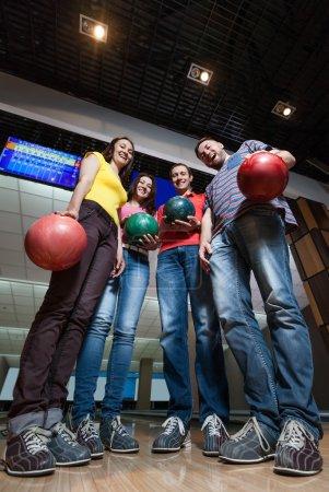 Friends having fun in bowling