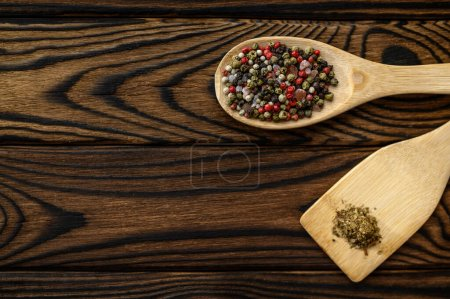 Photo for Fragrant spices in a spoon on wooden background, top view. Organic vegetarian food, grocery assortment, natural eco products, healthy lifestyle concept - Royalty Free Image