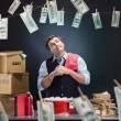 Glad businessman is laundering money banknotes in ...