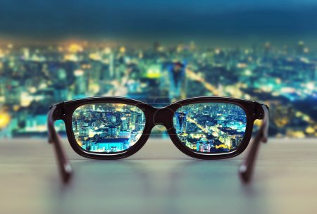 Night cityscape focused in glasses lenses