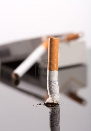 Cigarette butt against box