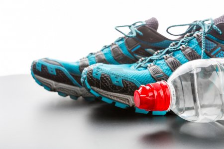 Photo for Closeup of sports runners and a bottle of water - Royalty Free Image